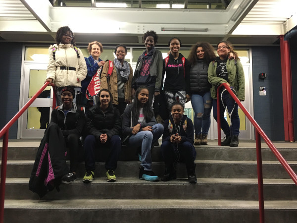 Aye, Cindy, Fatou, Djeneba, Emma Jaylene, Zeinab, Kiran, Kianna, Ajayla and mentor Katie huddle up outside of Chelsea Piers CT after their big win over Darien squash!